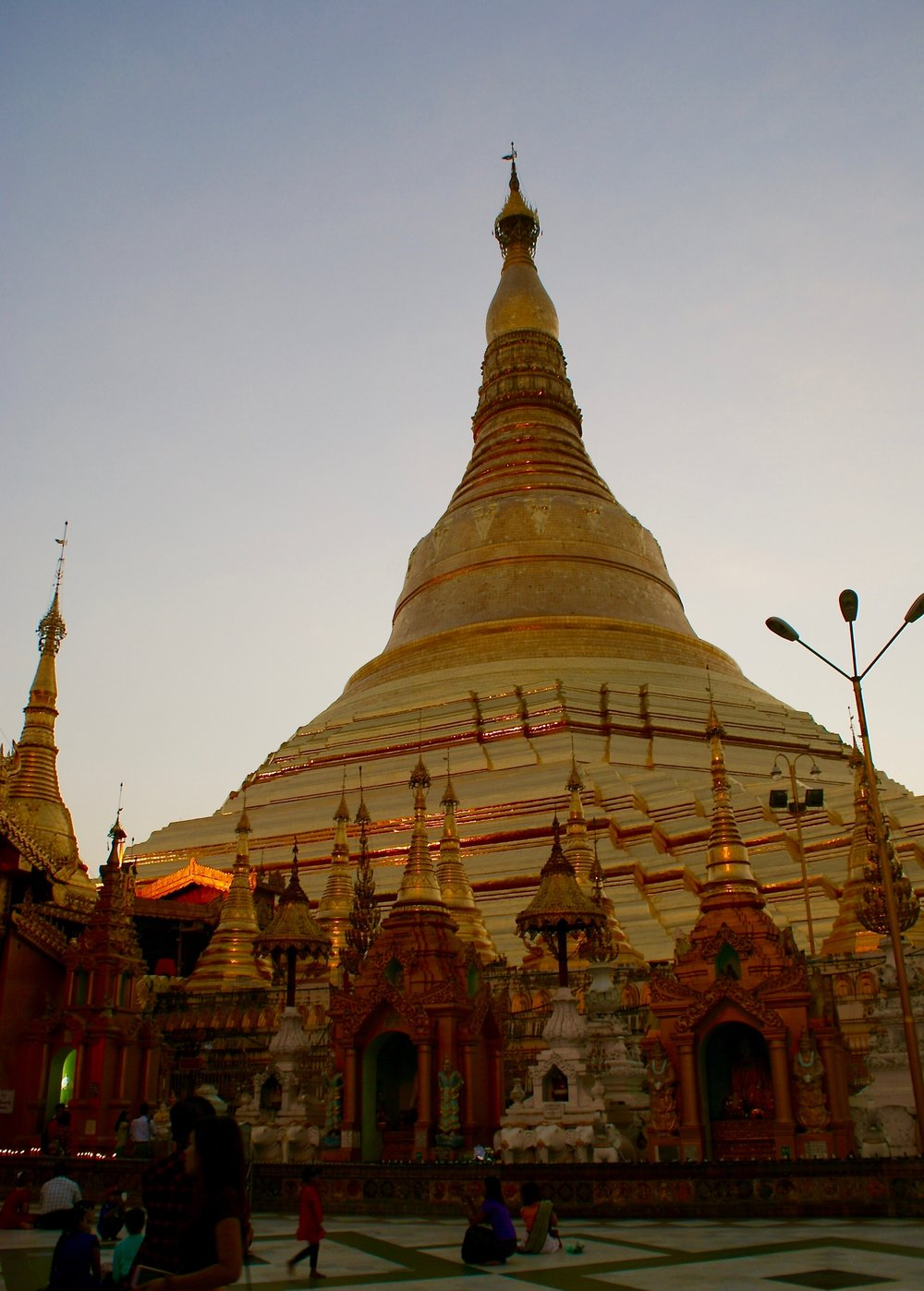 The Shwedagon Paya at sunset is a site to behold.  There are few photos that can even begin to do it justice.  The giant golden pagoda reflects light everywhere, it's a beacon that can be seen from miles away around the city of Yangon.