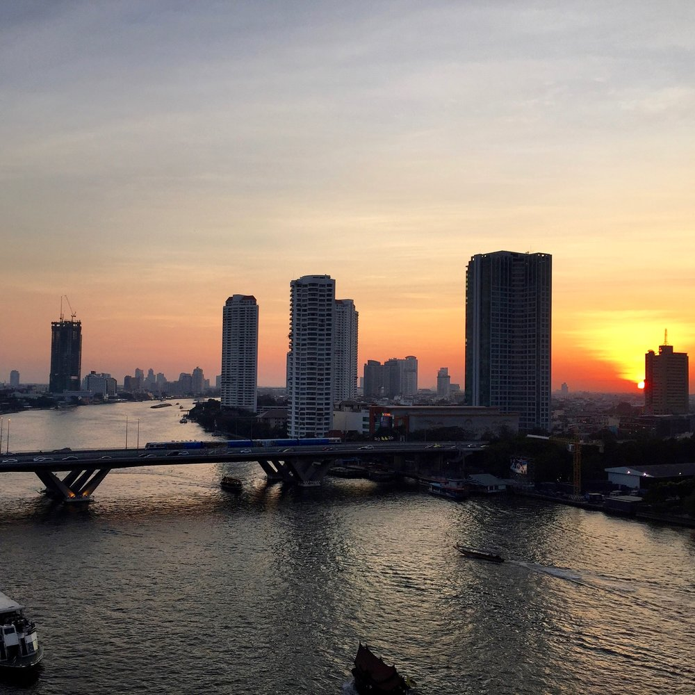 Sunset on the Chao Phraya river as seen from my hotel balcony. Sometimes the quiet nights in Bangkok are the best ones.
