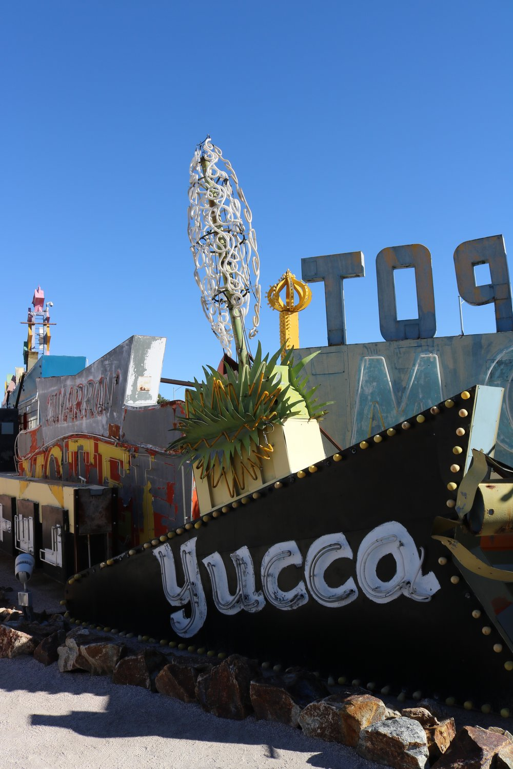 The Yucca Hotel Sign at the Neon Boneyard, is next level neon craftsmanship.  Each one of the pieces in the plant part of the sign were individually hand crafted.  I WISH I could see what this sign looks like lit up, I bet it's amazing.