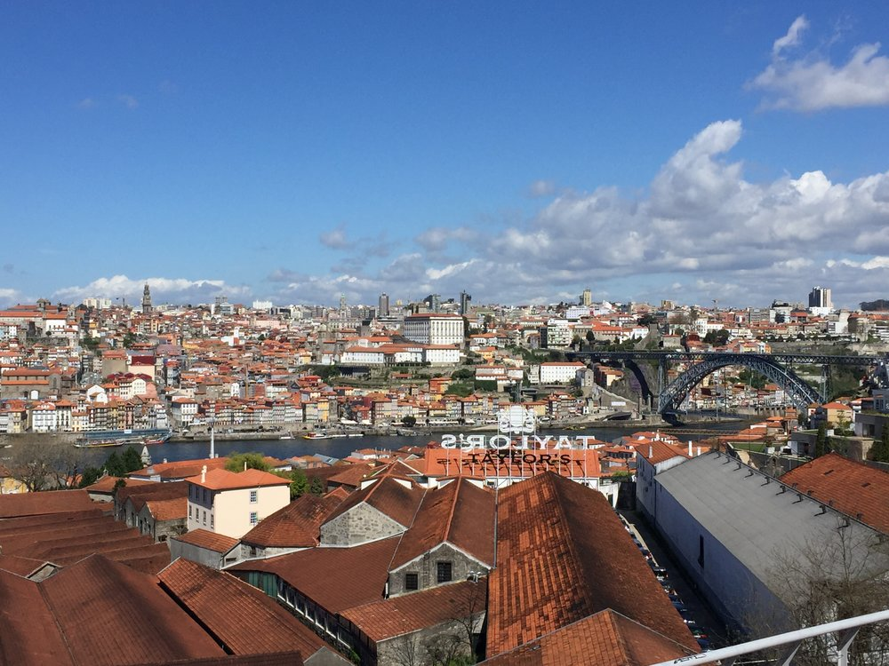 A view of the ancient city of Porto and the Dom Luis I bridge from the Gaia side (where they make all of the port, see the long roofs?  Those are port distilleries.)
