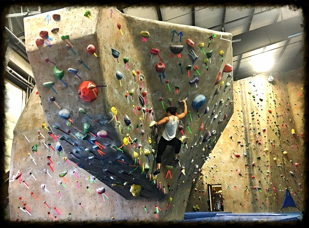 This is me bouldering on a V3 at Gravity Vault Middletown. This was a huge step for me physically, but it is surpassed by the emotional freedom I get from climbing up that wall.  Photo Credit: Larry Morris