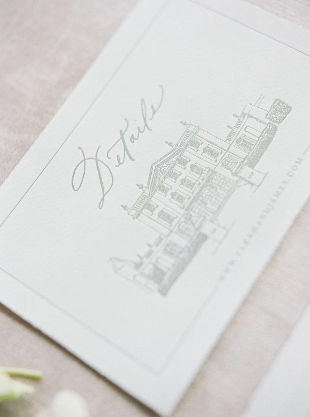 Letterpress details card with calligraphy and custom venue illustration.