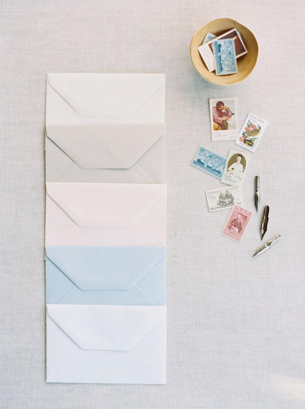 Ciarra Claire envelope color options. Natural white, warm grey, blush, pale blue, bright white.