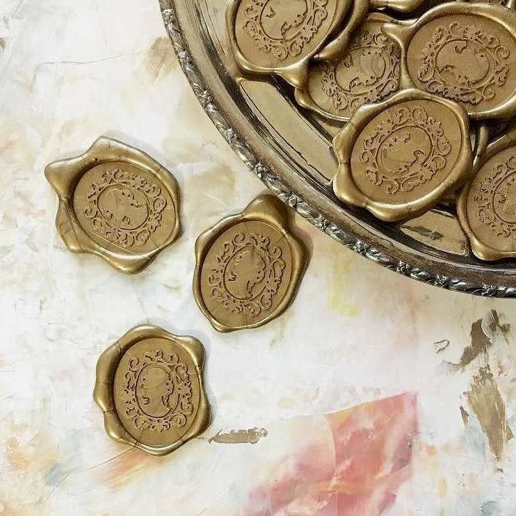 Cameo wax seal in gold.