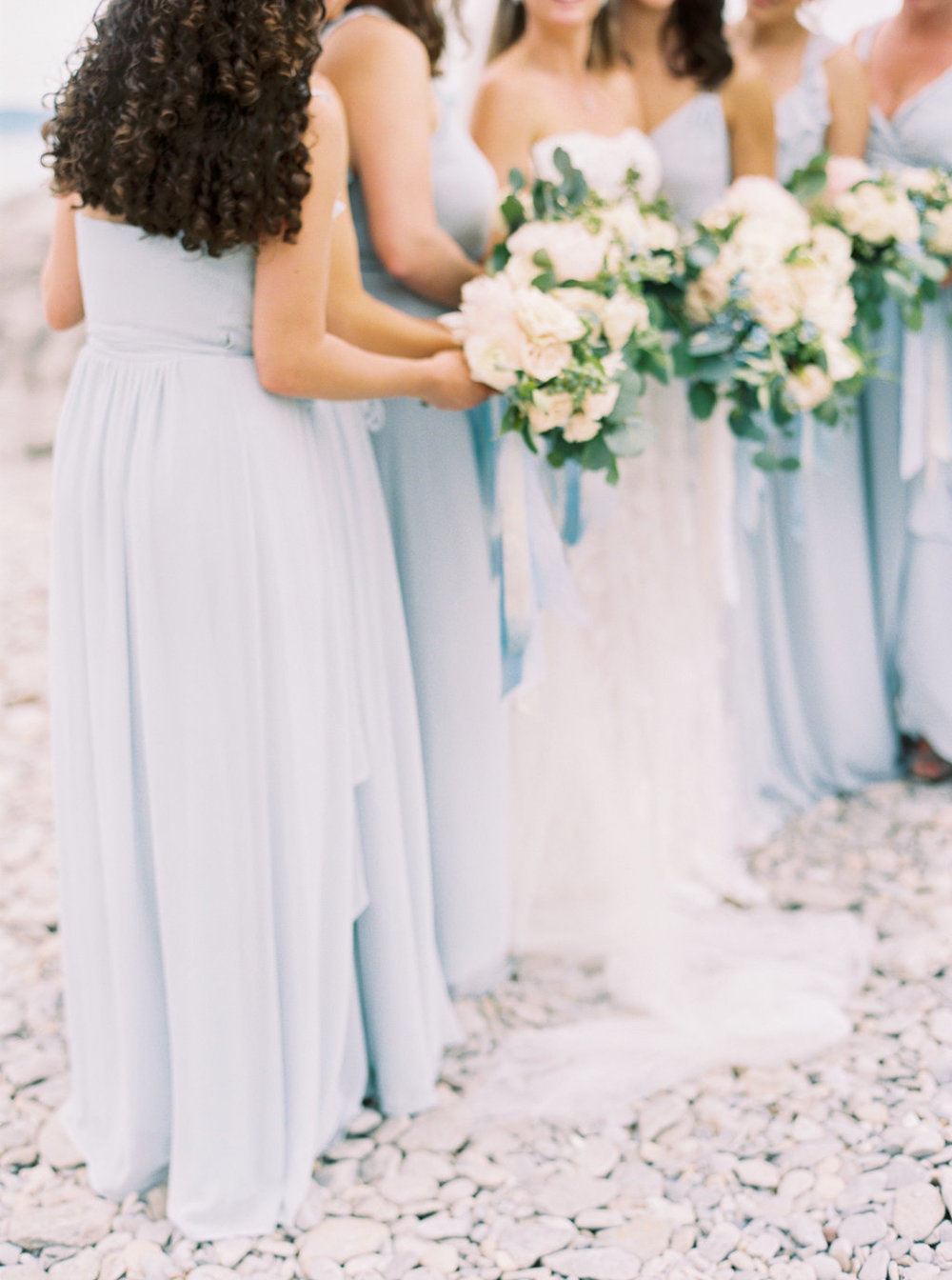 Dusty blue bridesmaid dresses for a summer wedding in Northern Michigan.