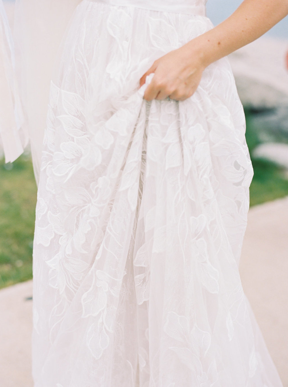 Bride delicate tulle and lace wedding dress for a summer wedding.