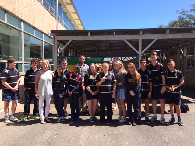 Year eight students and Humanities teacher Evan Polymenease in the centre who initiated the school program