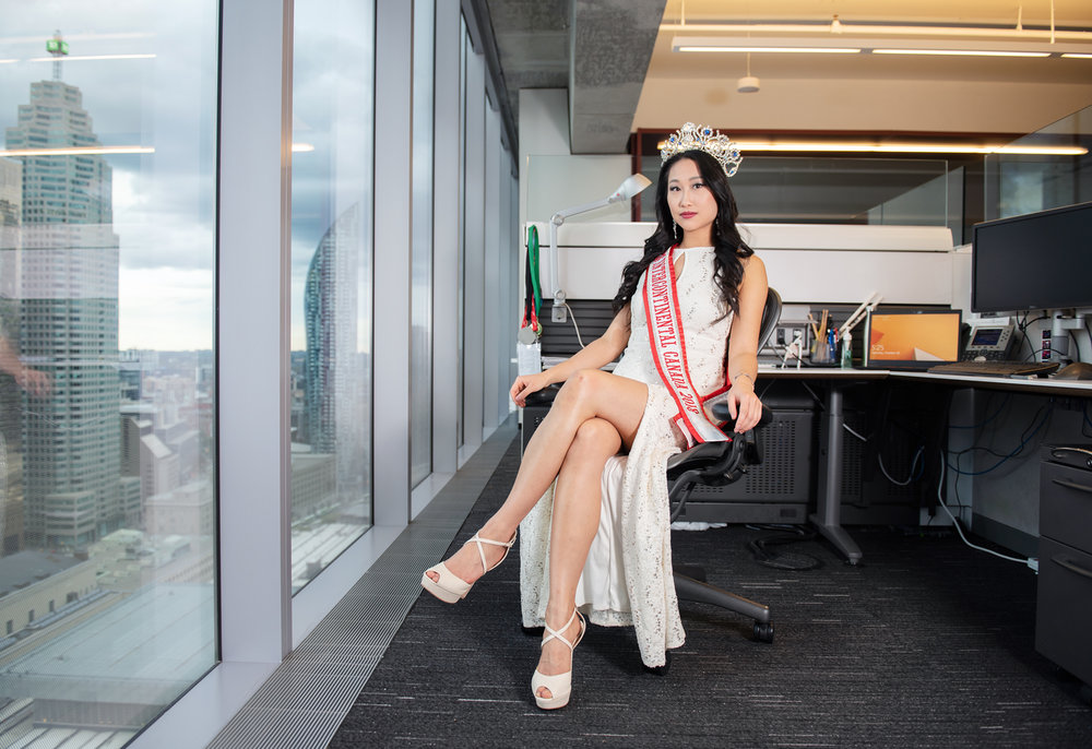 Alice Li, reigning Miss Intercontinental Canada 2018, at her office. She works full-time as an accountant while also doing pageants, and busking at TTC stations and other public places around Toronto for charity.
