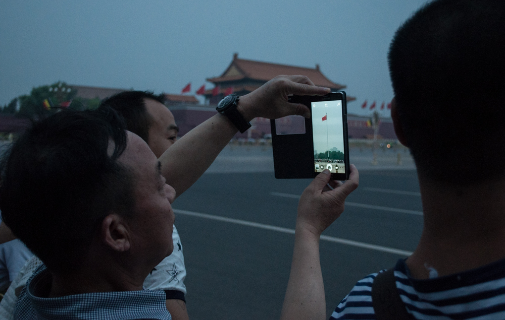 Flag Lowering ceremony in Tienanmen Square, Beijing, China. The ceremony is a daily occurrence.