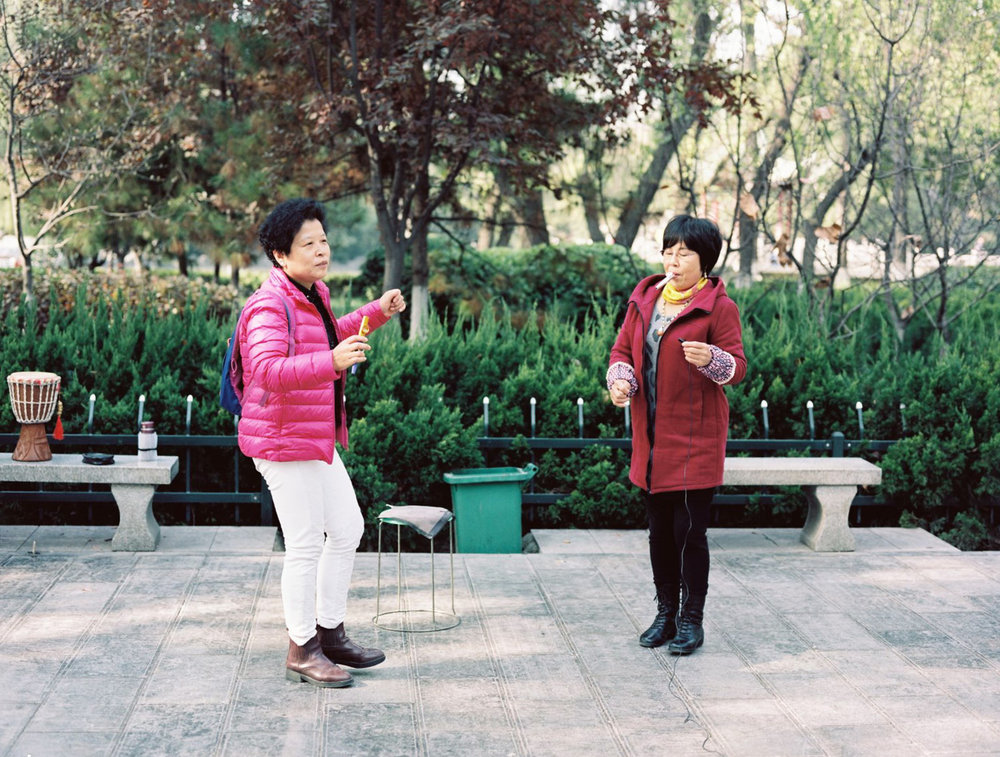Ladies playing the kazoo in Ge Ming park, Xi'an, China.