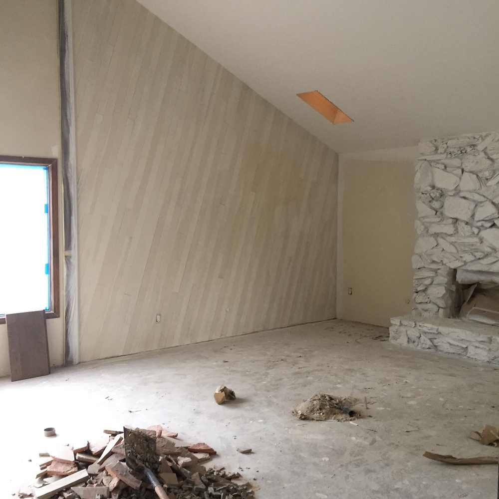 Eeeks! The 1970's stone fireplace is getting primer before it is painted SW Alabaster white. I can't wait to see if the fireplace looks good with a fresh coat of paint. If it doesn't look good, we'll need to replace the stone which is costly. We need to save wherever we are able.