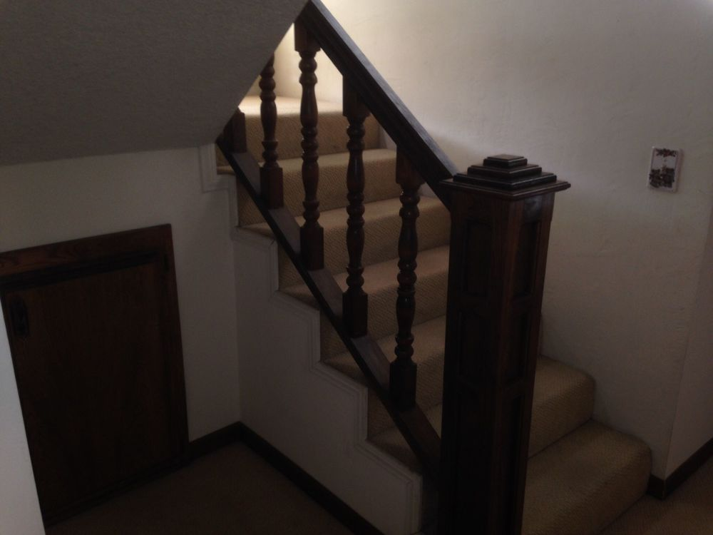 Staircase to the second floor leading to the master bedroom suite.