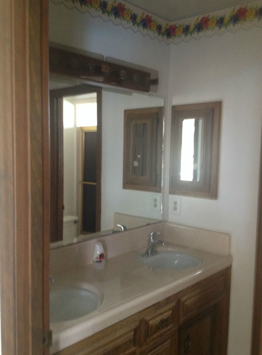 Hall Bath has two vanity sinks and a separate shower area.