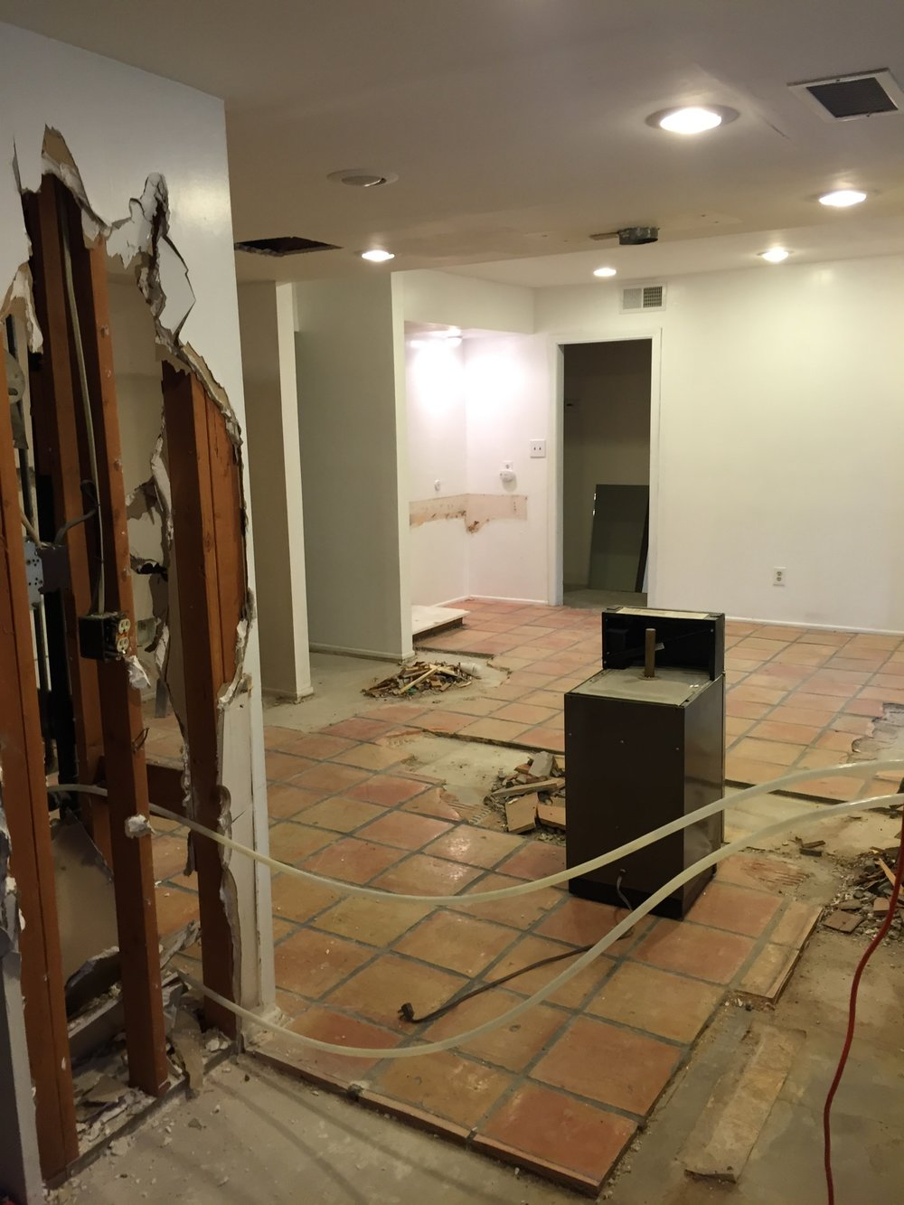 The entire kitchen is coming out including the wall between the kitchen and the dining/living areas. We are also tearing out all of the Spanish pavers. We LOVE Spanish pavers just not in this house.