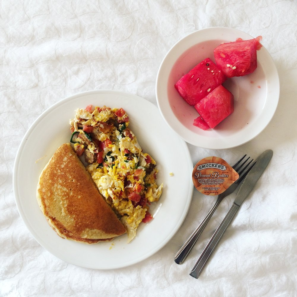 Made to order scrambled eggs, a WHOLE pancake, and some watermelon.