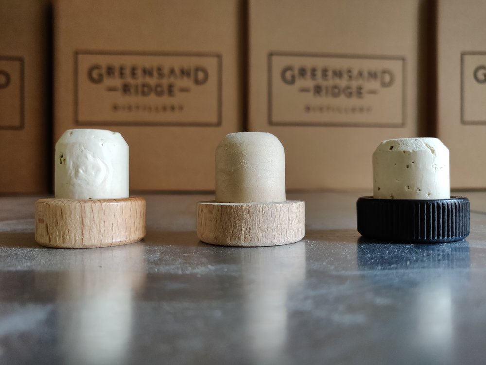 Our journey in closures (l-r): natural Cork, plastic shank, natural Cork with black painted wood.