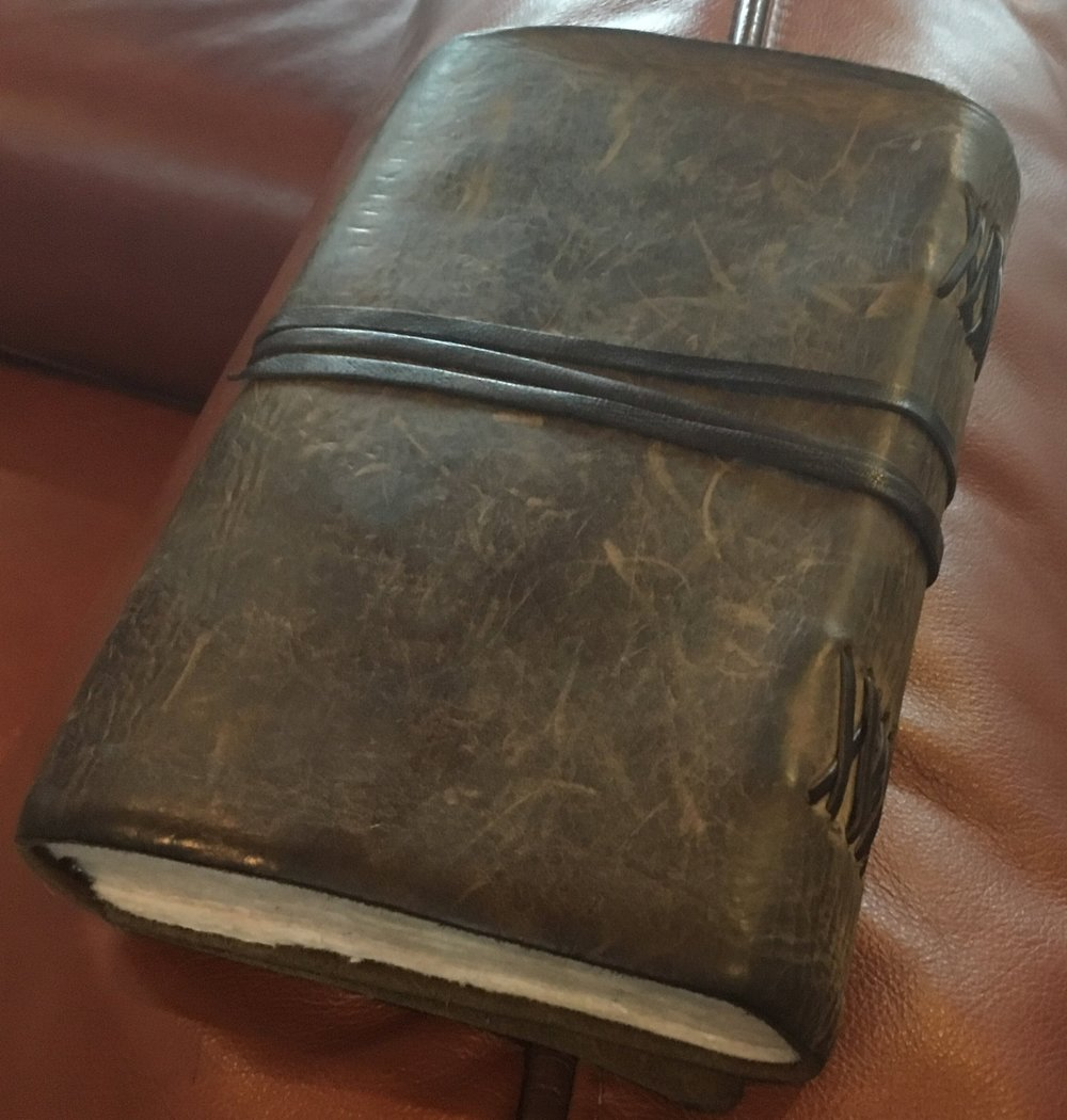 Olivia's handmade book of her writings. Beautiful leather with recycled cloth pages.