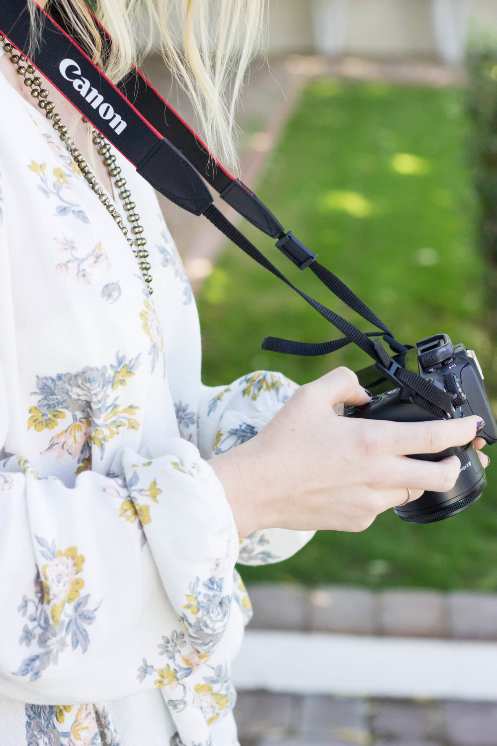 Woman with a DSLR Camera