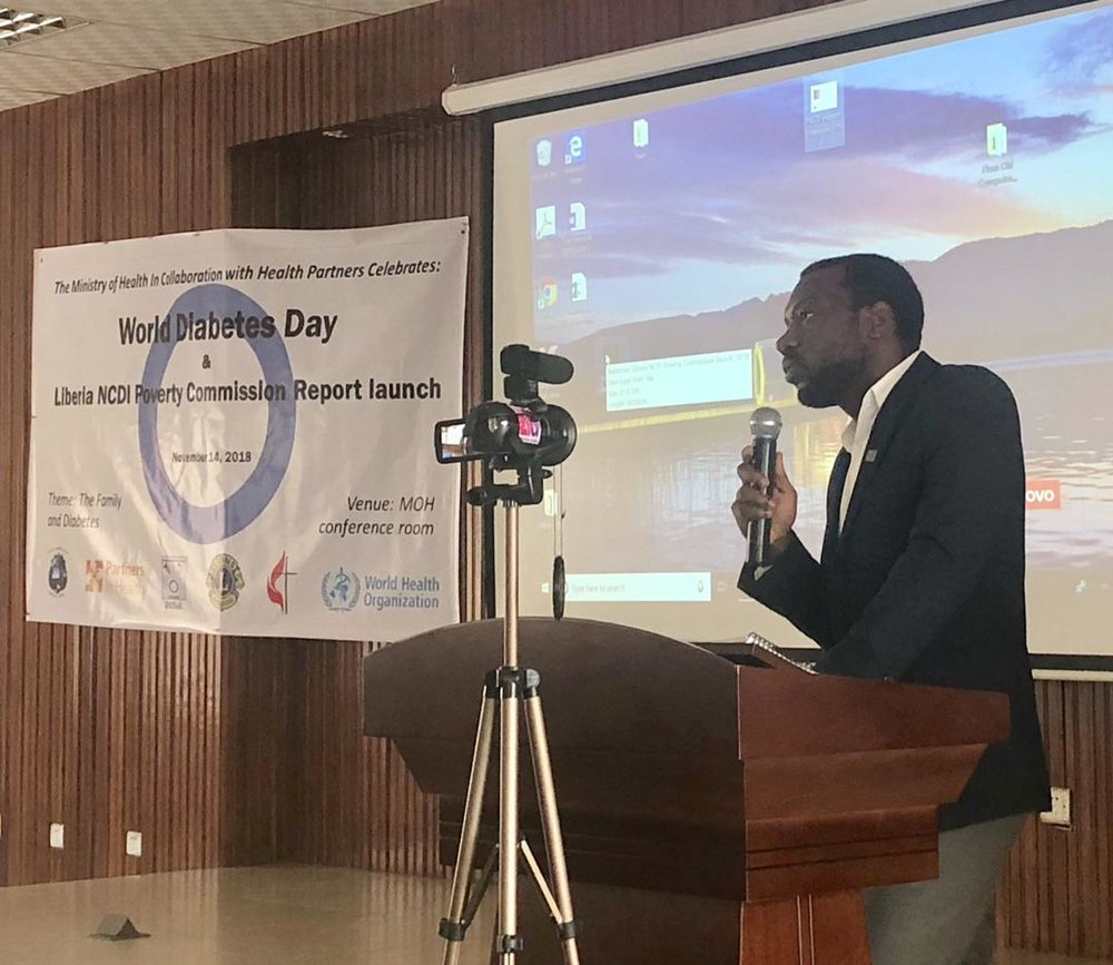 dr. fred amegashie, co-chair of the liberia ncdi poverty commission, presents key findings and recommendations at the official launch of the commission report.