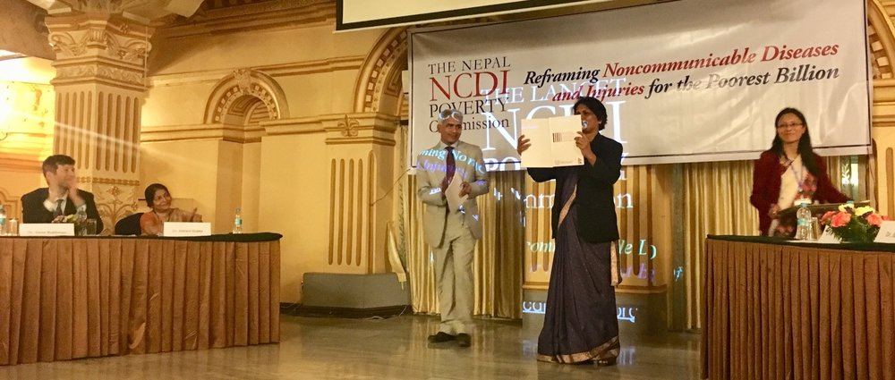 Dr. Pushpa Chaudhary , Secretary of the Nepal Ministry of Health, officially launches the report with the Nepal NCDI Poverty Commission Co-Chair, Dr. Bhagawan Koirala.