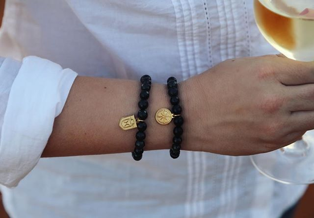 Breed charms abroad! These onyx bracelets paired perfectly with Chenin Blanc in South Africa's wine lands