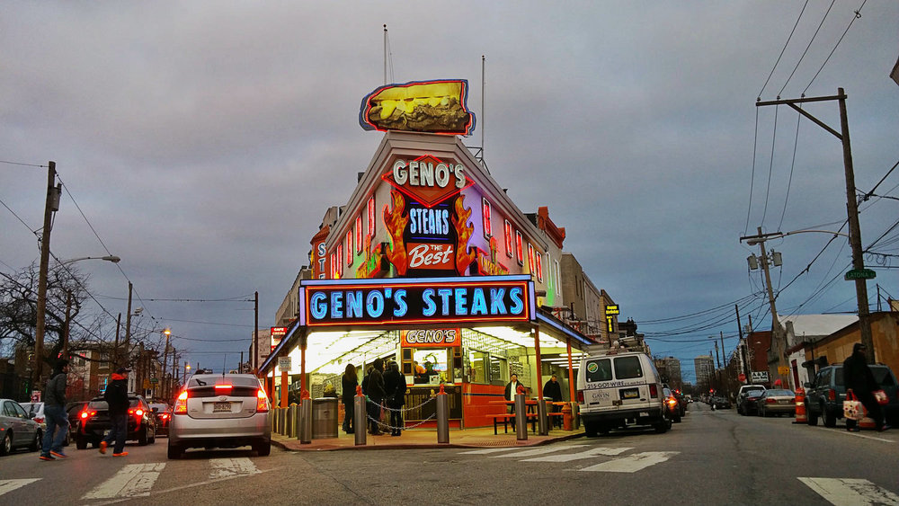 Geno's Steaks , a Philly cheesesteak original. Pat's King of Steaks is across the street. Both are open 24/7 and are always packed.