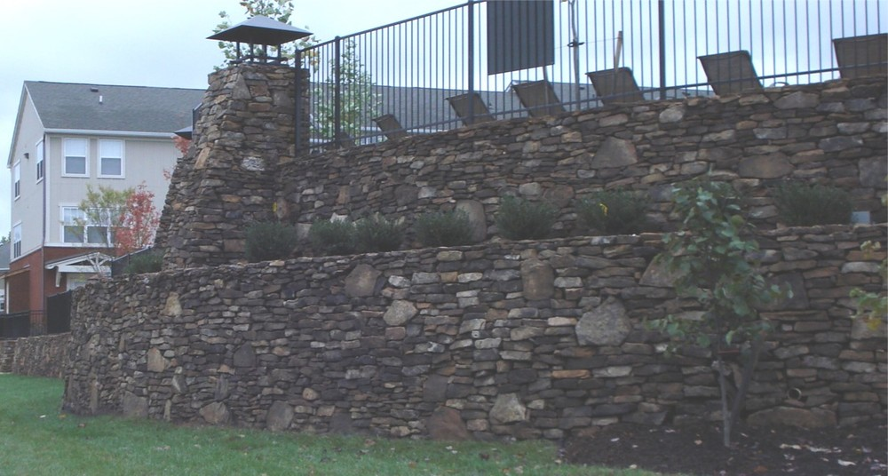 MSE Rock Filled Wire Face Retaining Wall with Natural Stacked Stone Cladding