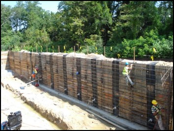 Soldier Pile Retaining Wall with Cast In Place Concrete Facing