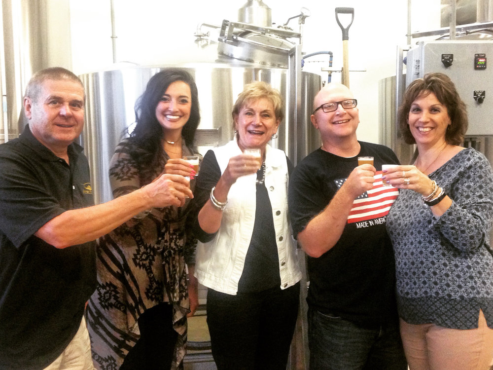 Mike, Emily, and Jan, toast the first pour of Little Crossings Tavern Ale with George and Susan Walker of Whitehorse Brewing in Berlin, PA