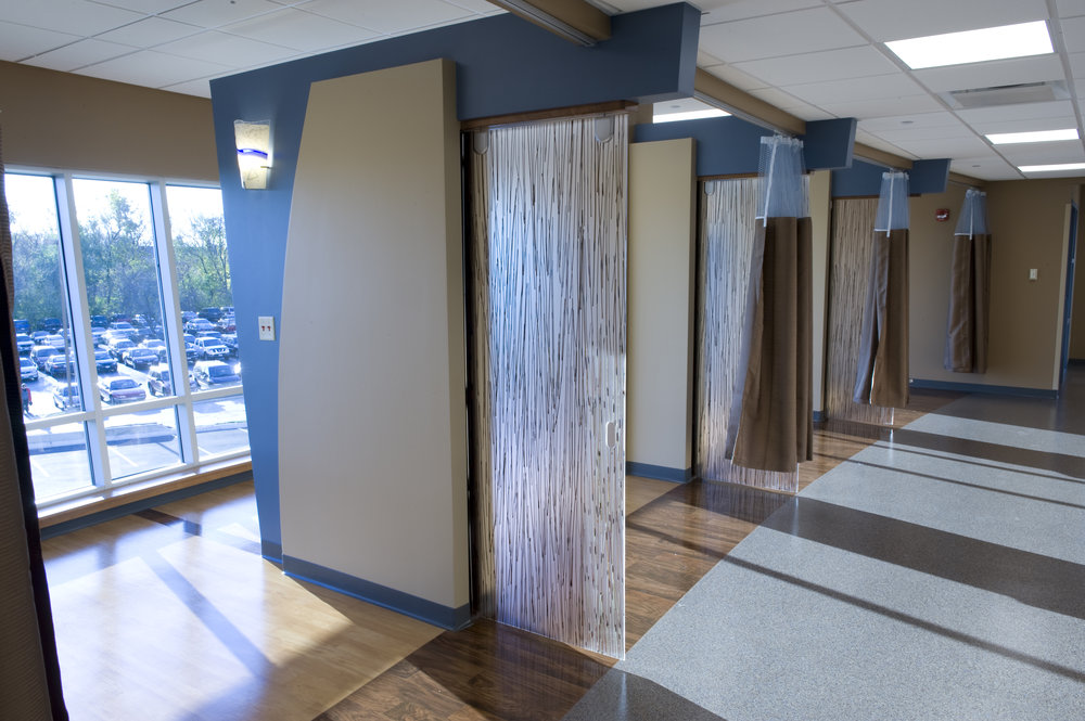 Infusion treatment bays feature sliding doors and curtains for different privacy needs.
