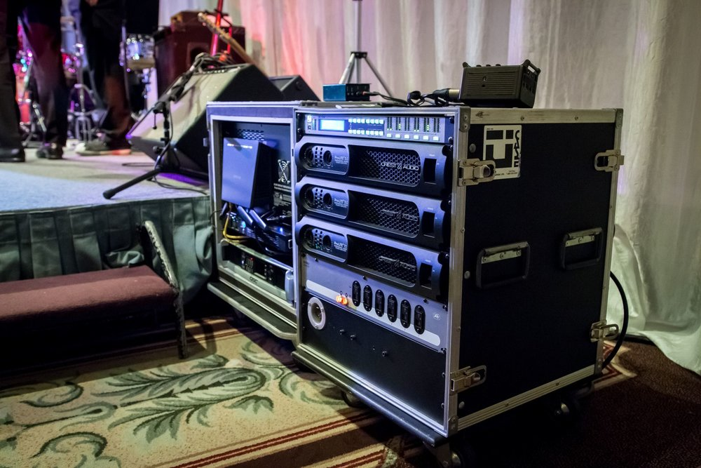A-Rig Amp & Power Distro Rack and Mixer Racks Setup tidily side stage at an event.