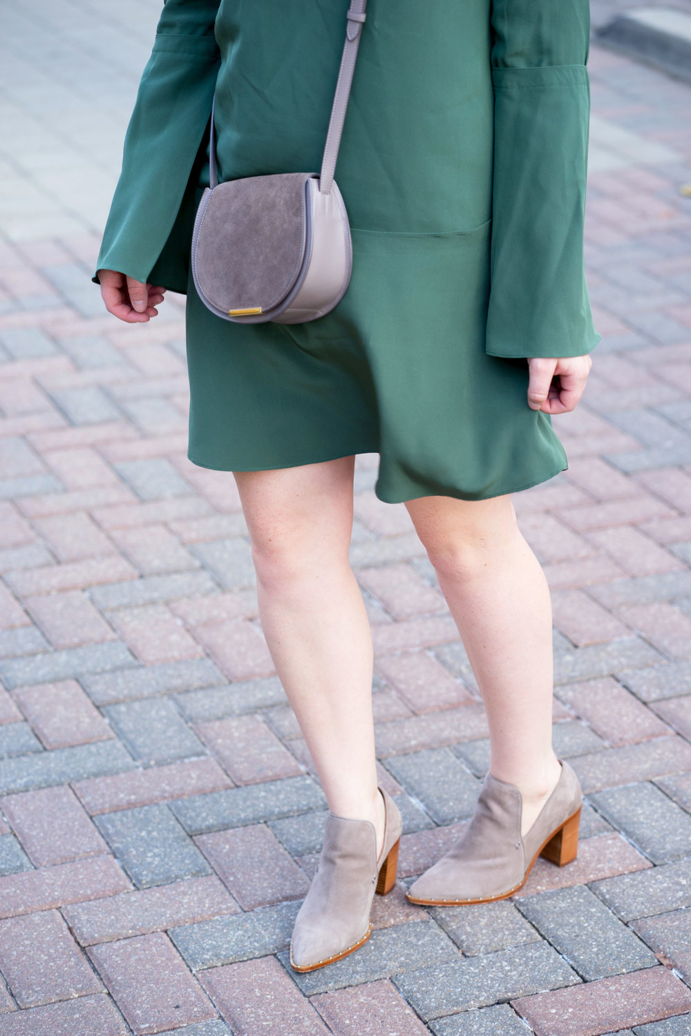 Maggie a la Mode - Schutz Fomo Bootie, Tibi Green Silk Fluted Bell Sleeve Dress, Cuyana Mini Saddle Bag, Warby Parker Aldridge Sunglasses, Madewell Earrings