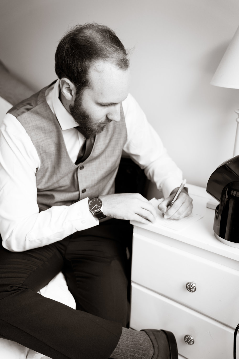Groom writing note before ceremony, Downtown Greenville