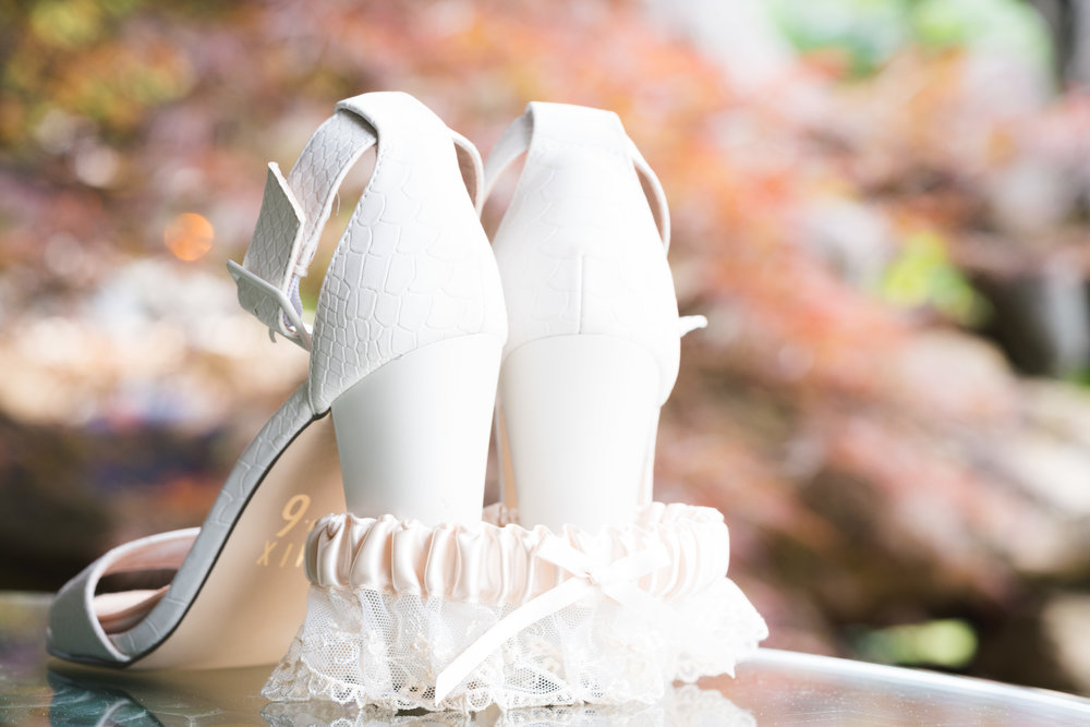 Brides shoes and garter - Viewpoint at Buckhorn Creek | Greenville, SC