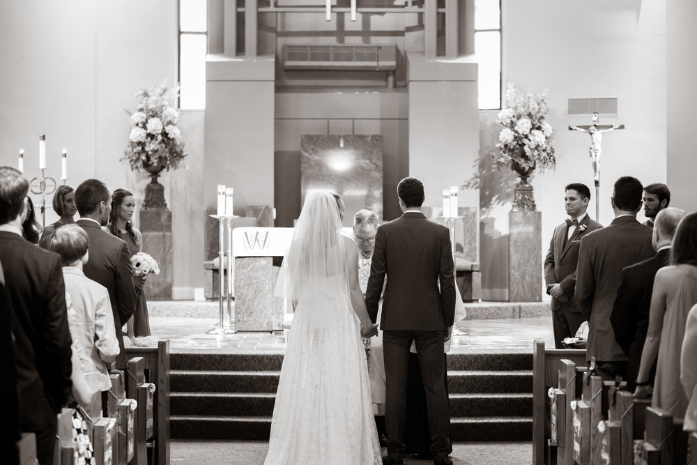 Bride and groom approaching the alter | St Mary Magdalene Catholic Church Simpsonville, SC
