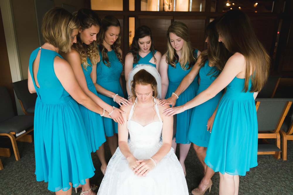 Bridal party praying with bride | St Mary Magdalene Catholic Church Simpsonville, SC