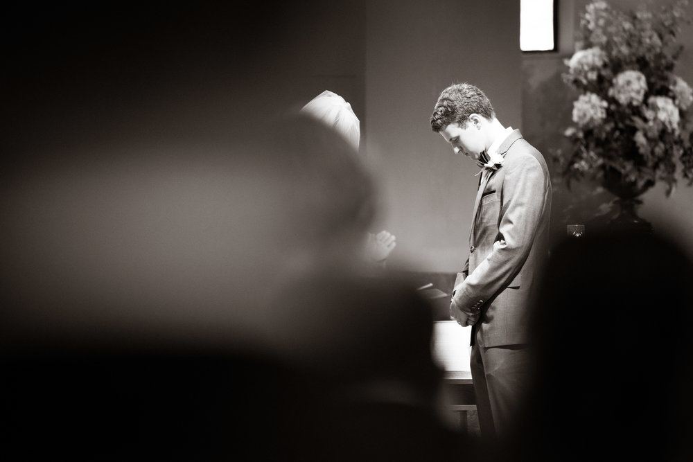 Groom praying at the alter | St Mary Magdalene Catholic Church Simpsonville, SC