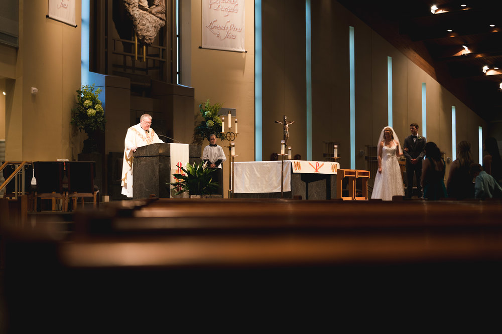 Bride and groom at the alter | St Mary Magdalene Catholic Church Simpsonville, SC