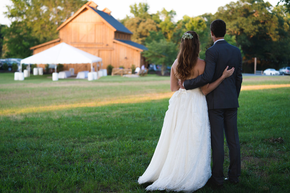 Bride and groom arriving to reception venue | Windy Hill Wedding and Event Barn in Simpsonville, SC