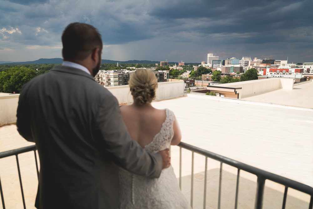 Bride and groom looking over Downtown Greenville, SC
