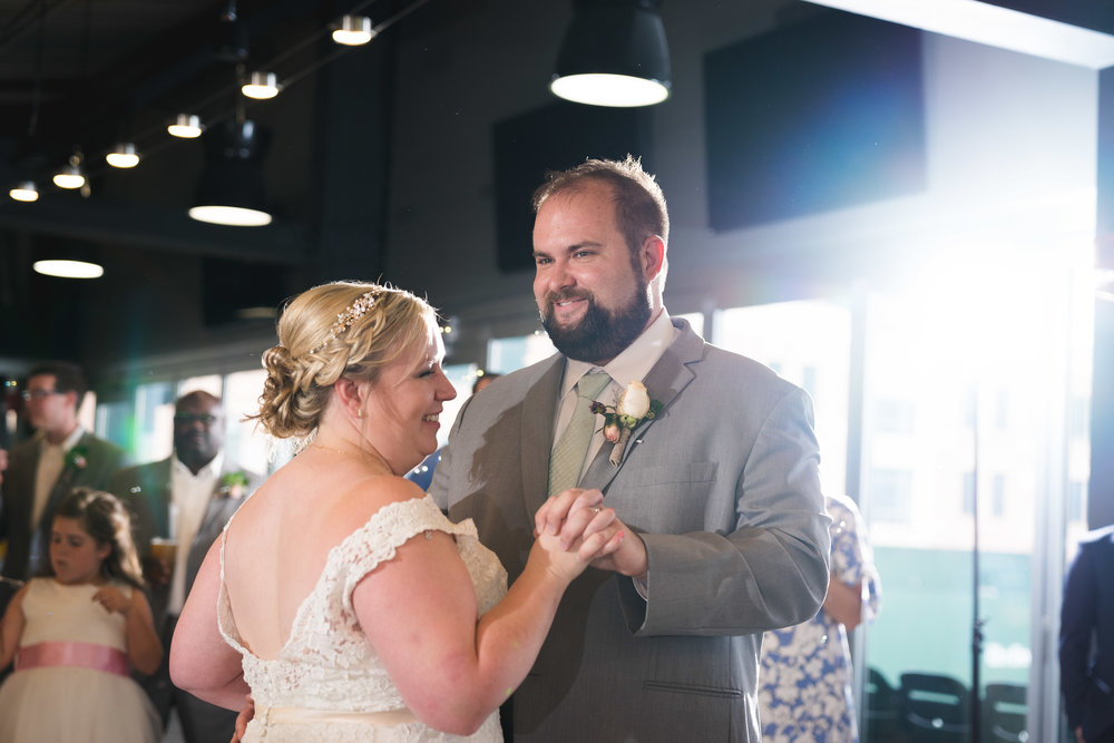 Bride and groom dancing | Flour Field Wedding in Downtown Greenville, SC