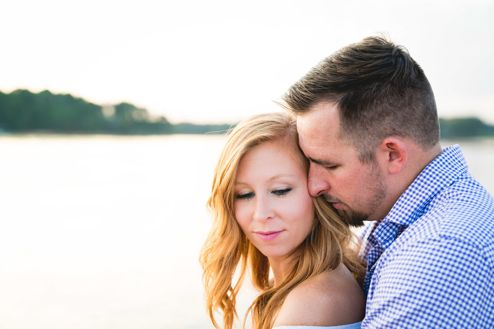 Watching sunset on lake Hartwell | Engagement Session in Clemson SC