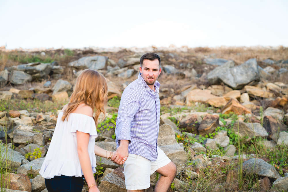 Climbing the rocks on Lake Hartwell | Engagement Session in Clemson SC