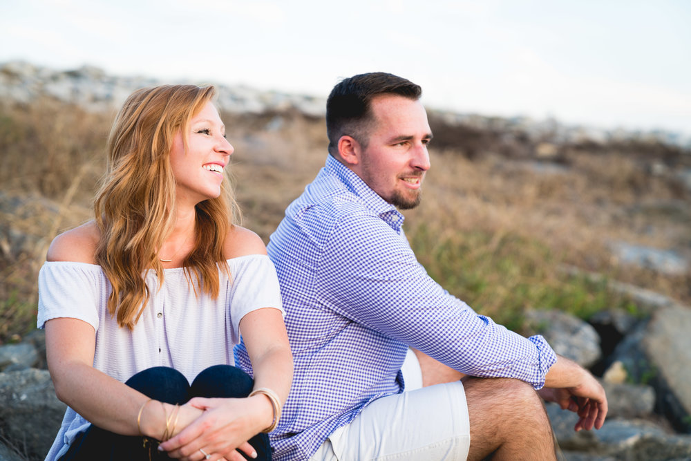 Watching sunset on the rocks | Engagement Session in Clemson SC
