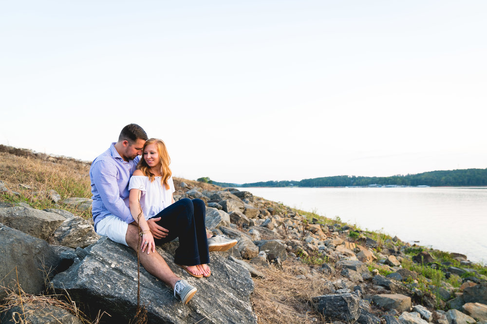 Couple watching sunset together | Engagement Session in Clemson SC