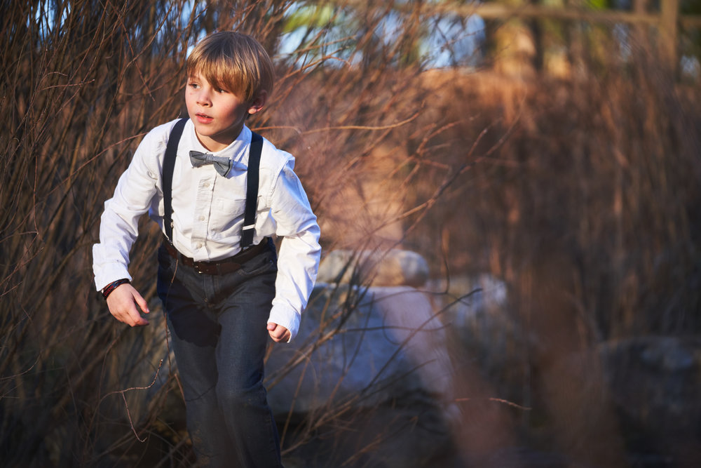 Boy walking into the sun | Family Photo Session at the Clemson Botanical Gardens