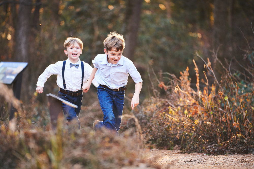 Brothers chasing eachother | Family Photo Session at the Clemson Botanical Gardens