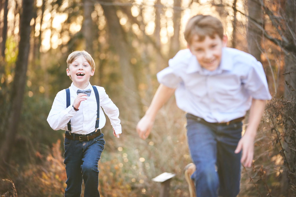 Boys chasing eachother | Family Photo Session at the Clemson Botanical Gardens