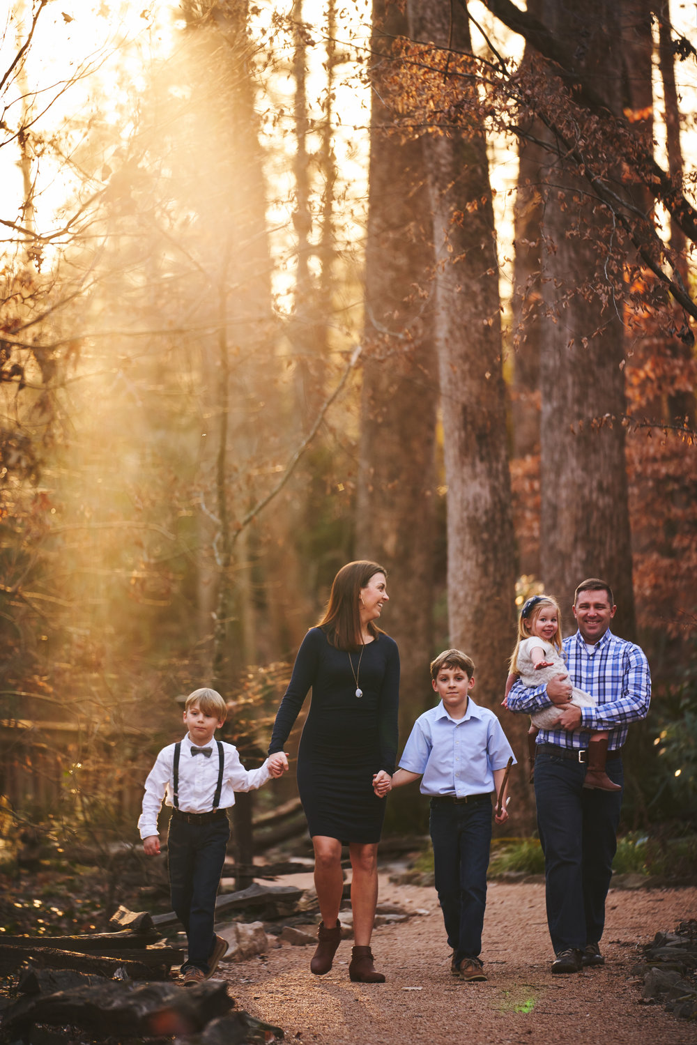 Family walking in the sun | Family Photo Session at the Clemson Botanical Gardens