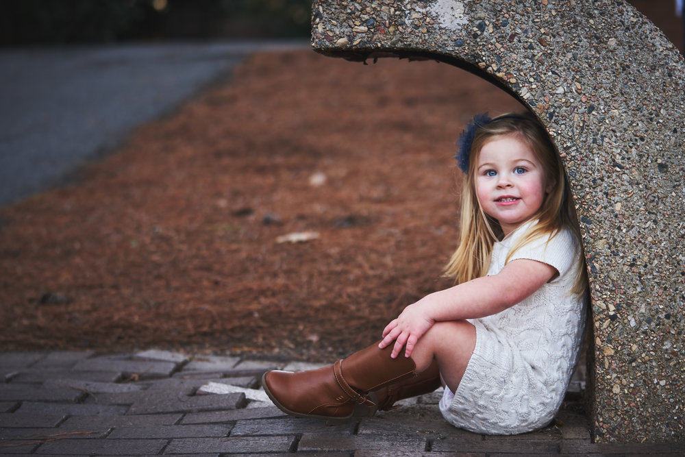 Little girl posing for picture | Family Photo Session at the Clemson Botanical Gardens